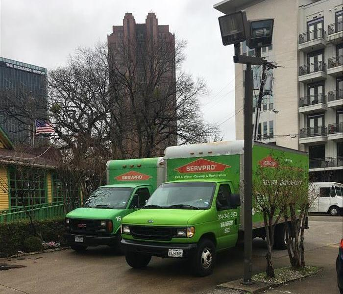Two SERVPRO trucks parked.