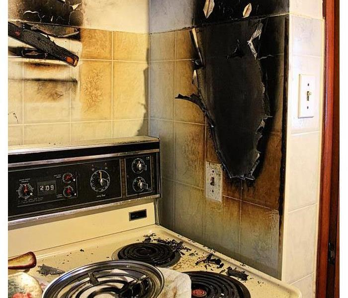 Damaged walls after a kitchen grease fire
