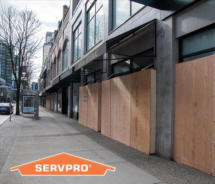 Stores in downtown Vancouver boarded up to prevent break-ins while closed for business because of Covid-19.